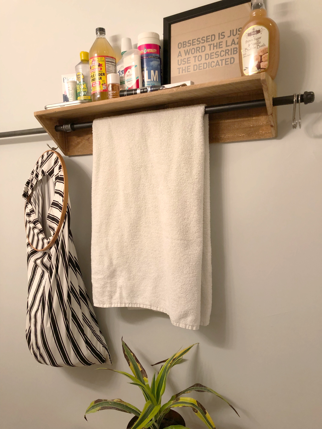 DIY bathroom renovation with towel rack and organization cart.