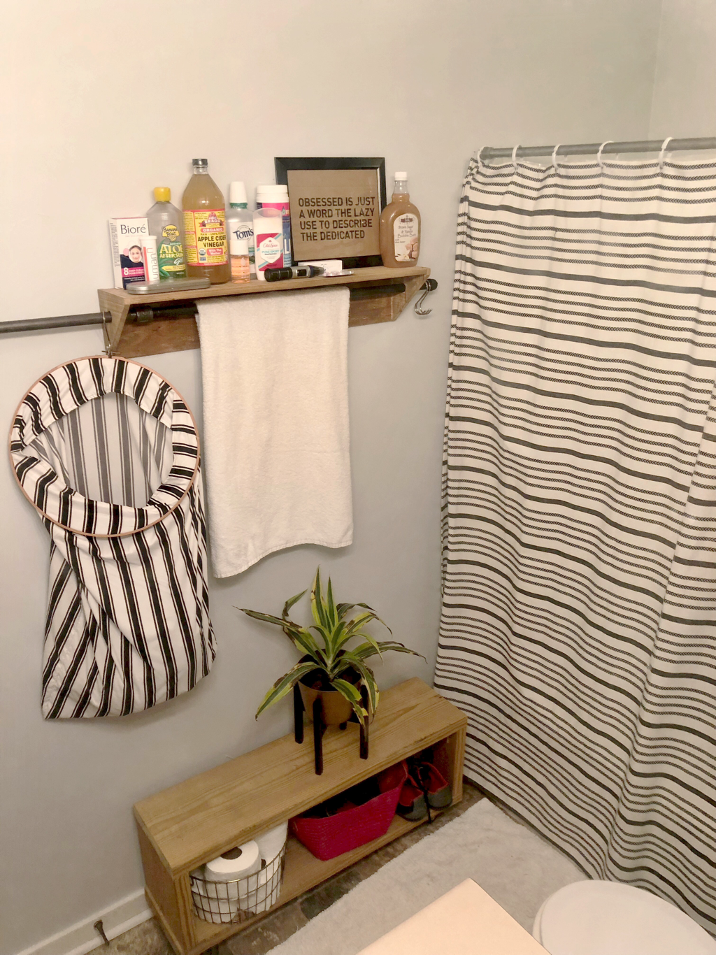 DIY bathroom remodel with DIY towel rack and organization hacks.