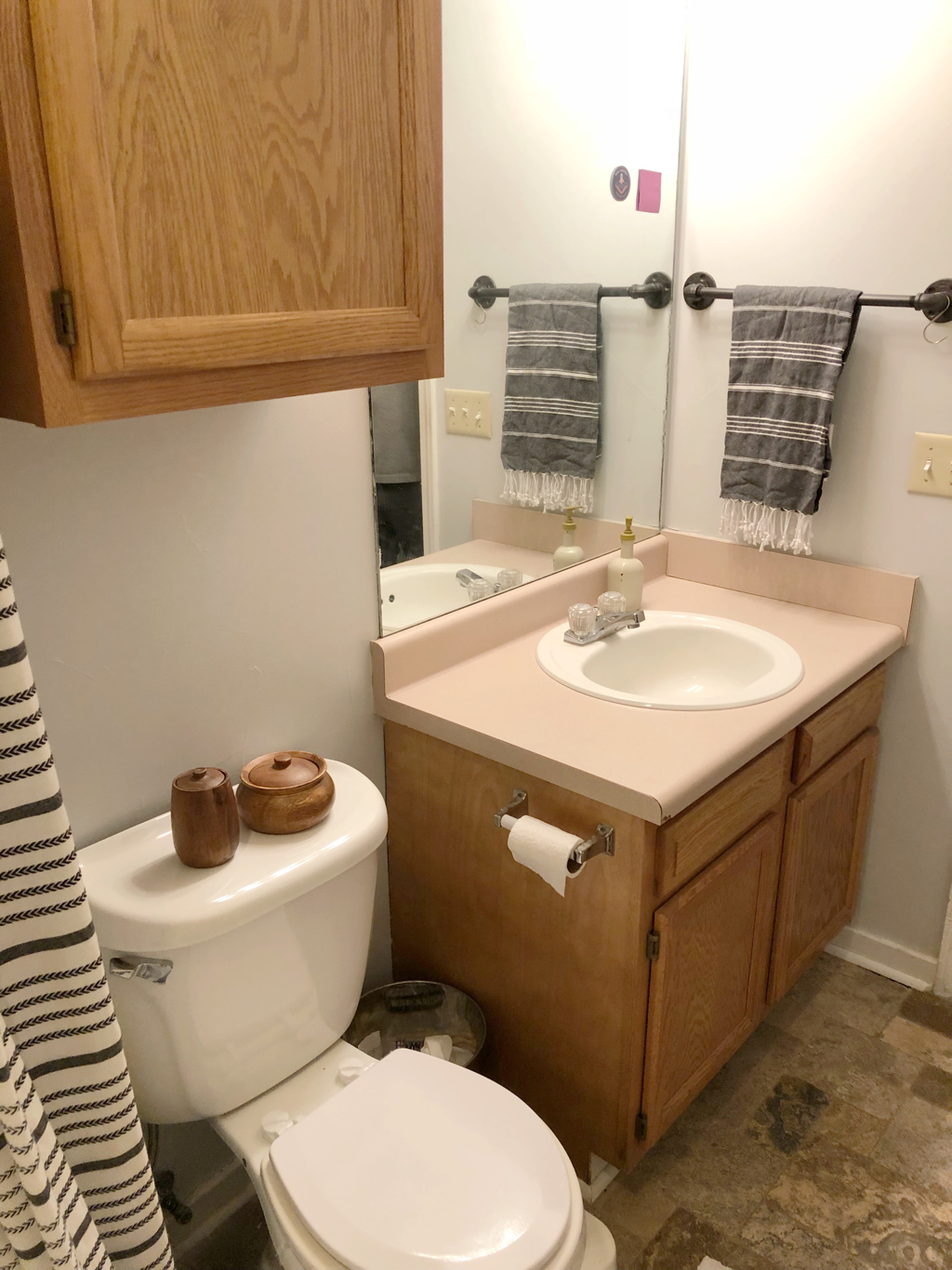 Bathroom remodel after new paint job and towel racks.